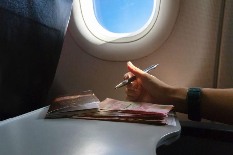 airplane-window-currency-cabin-indonesian-shutterstock_1329187910