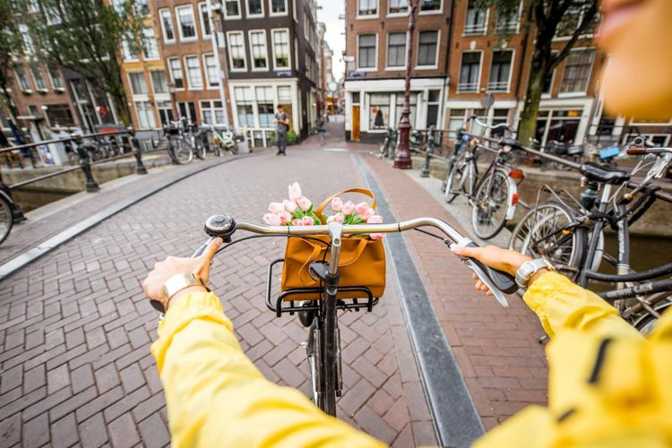 Amsterdam on a bicycle © RossHelen/Shutterstock
