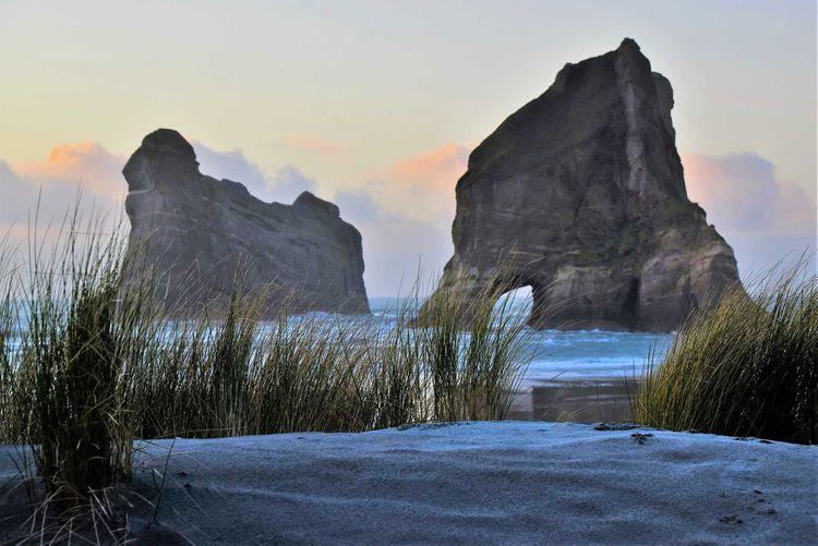 archway-islands-wharariki-beach-shutterstock_1017315196