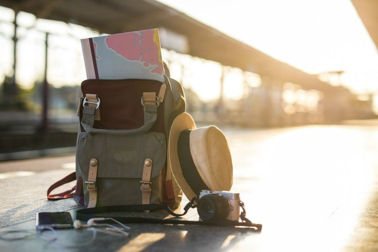 backpack-map-travel-hat-camera-earphone-train-station-shutterstock_785154337