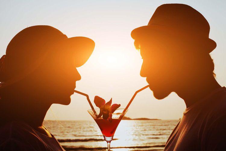 beach-drink-couple-shutterstock_247281169