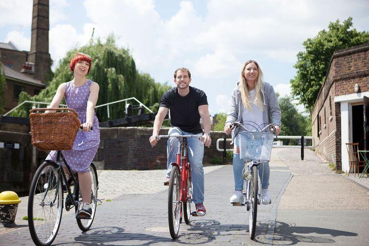 Riding bike along canal, East London, UK ©  Image Source Trading Ltd/Shutterstock