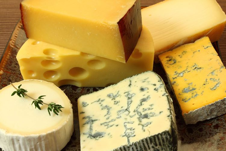 Cheese plate - various types of soft and hard cheese © Krzysztof Slusarczyk/Shutterstock