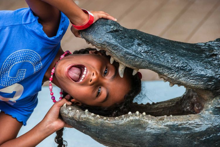 child-fun-aligator-florida-miami-usa-shutterstock_265407668