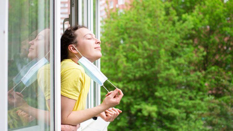 coronavirus-lockdown-mask-window-shutterstock_1721230048