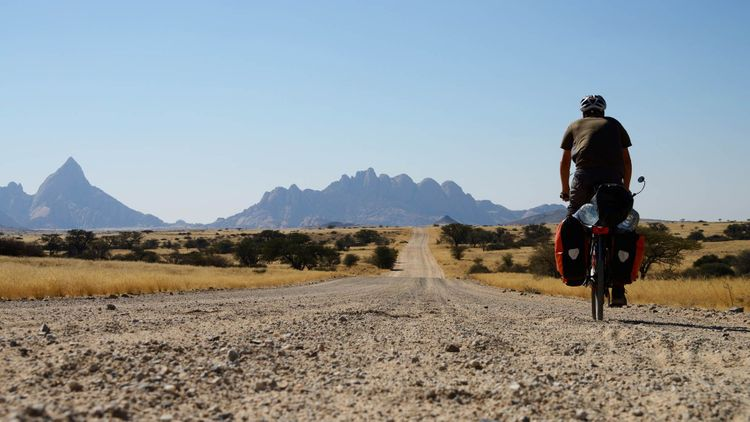 Long distance cycling at Spitzkoppe, Namibia © TravelNerd/Shutterstock