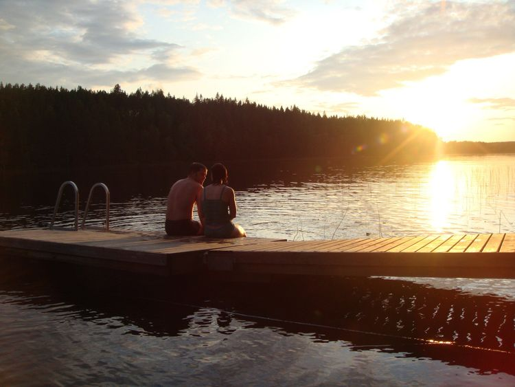 Couple on lake at sunset in Finland, honeymoon tips