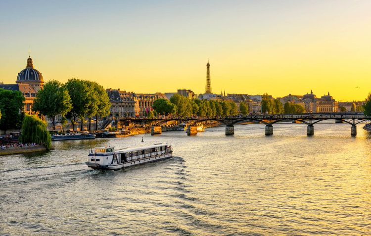 eiffel-tower-pont-des-arts-seine-river-paris-france-shutterstock_731364700
