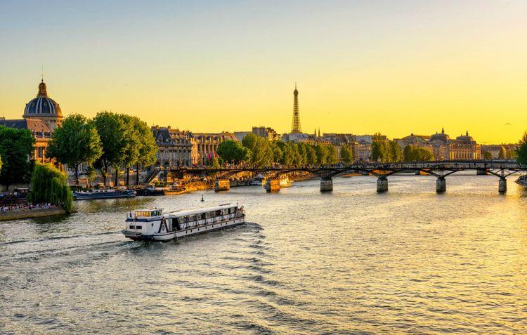 eiffel-tower-pont-des-arts-seine-river-paris-france-shutterstock_731364700
