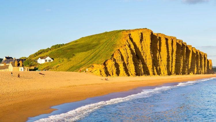 Evening light on the golden cliffs at West Bay Dorset England © ian woolcock/Shutterstock