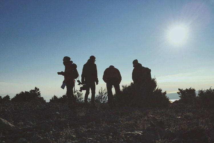 Backpackers on hilltop