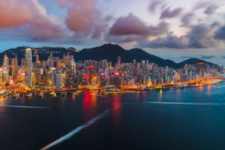 hong-kong-island-victoria-harbour-sunset-shutterstock_1180711618