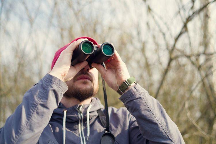 man-binoculars-birdwatching-shutterstock_1087826783