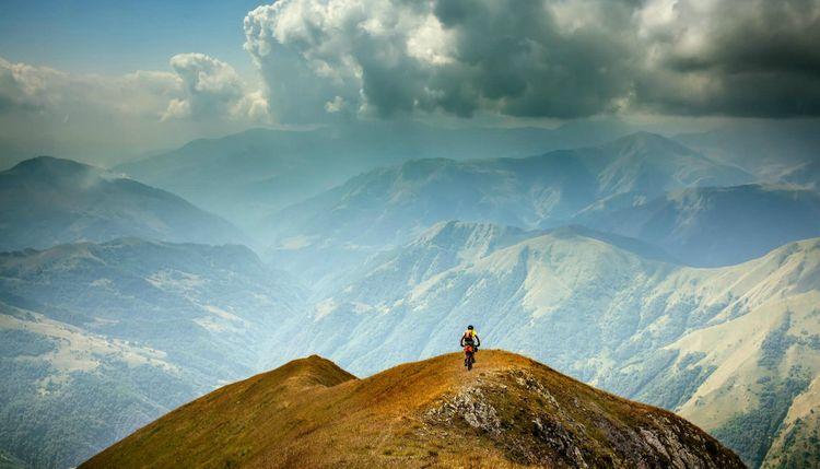 mountain-biker-tusheti-georgia-shutterstock_1131111338