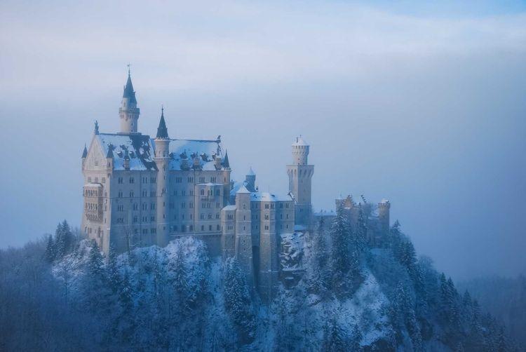 neuschwanstein-castle-fog-shutterstock_261214424
