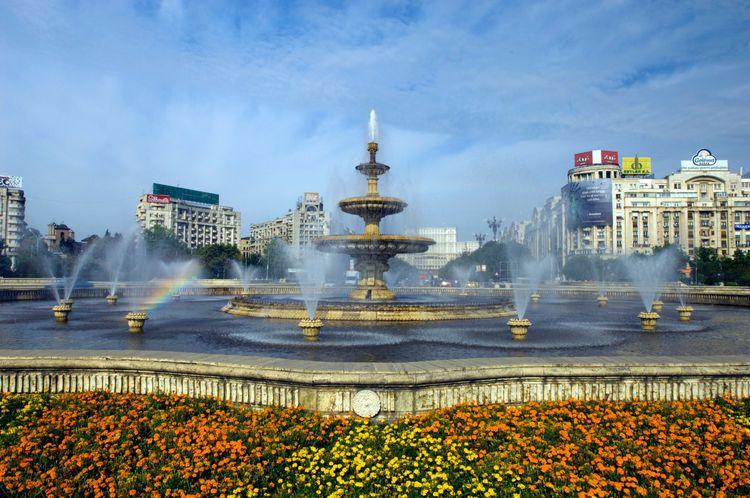 Palace of Parliament and fountain on Piata Uniri, Bucharest, Romania