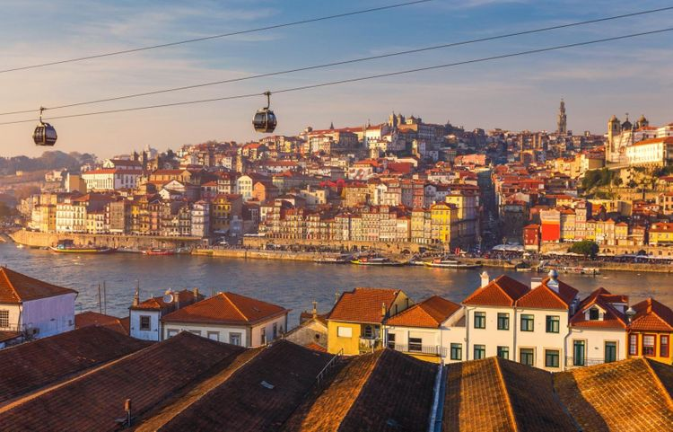Porto Ribeira, traditional facades, old multi-colored houses with red roof tiles on the embankment in the city of Porto, Portugal