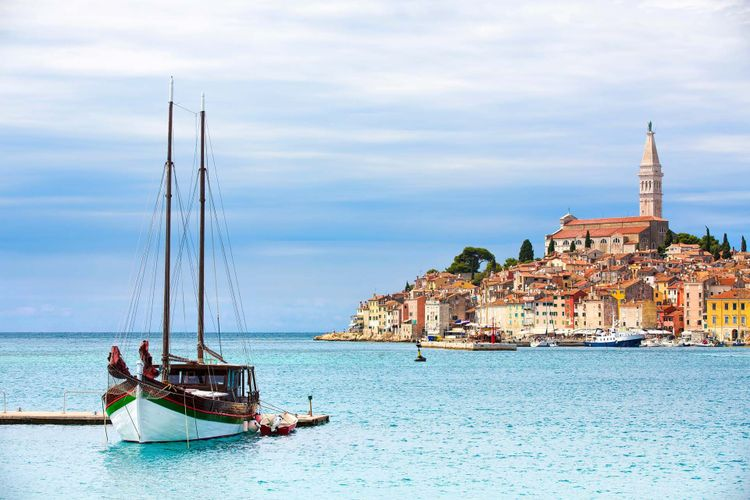 View of Moored Boat and the Old City in Rovinj, Croatia © Rolf E. Staerk/Shutterstock