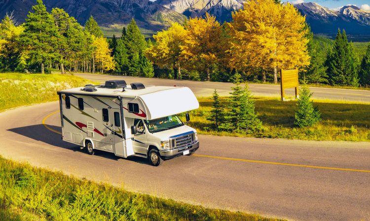 RV Motor home Camper On Scenic Highway in USA © Joshua Woroniecki/Shutterstock