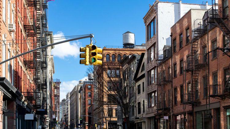 Historic buildings along Spring Street on a bright sunny day in Manhattan, New York City © Ryan DeBerardinis/Shutterstock