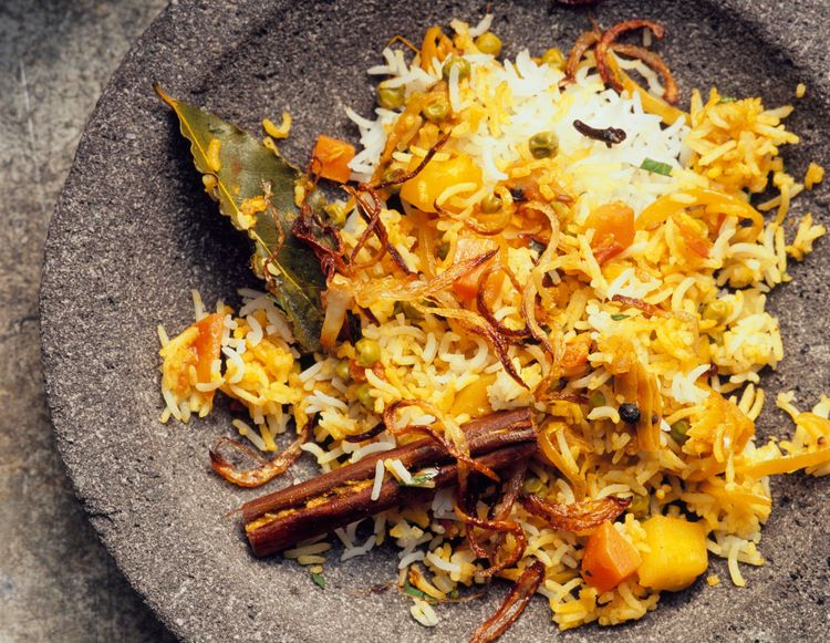 Subzi biryani, vegetable biryani with carrots, potatoes, fried onions, cinnamon, bay leaf