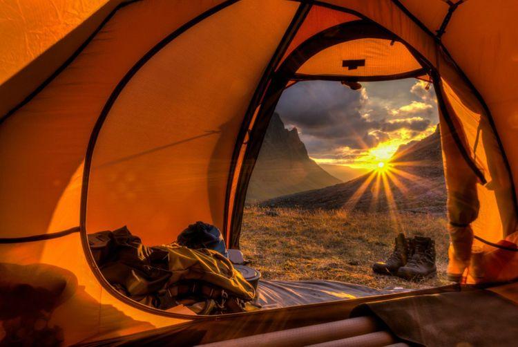 tent-sunrise-shutterstock_155077604