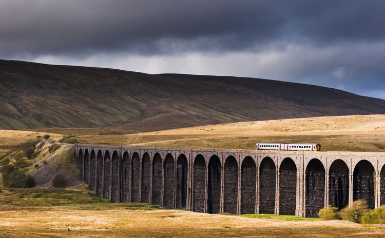 Train on the Settle to Carlisle railway crossing the Ribblehead viaduct
