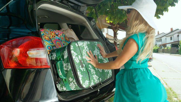 woman-car-travel-bags-shutterstock_1125848105